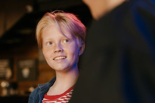 Girl in Blue Denim Jacket Smiling