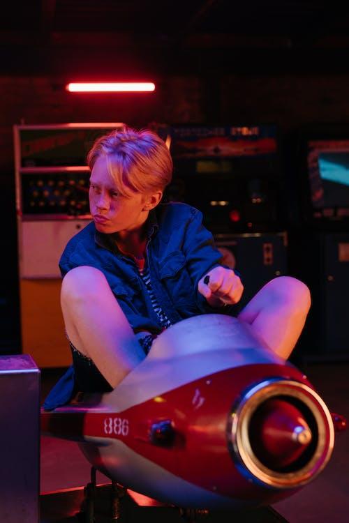 Woman in Blue Denim Jacket Sitting on Red Car