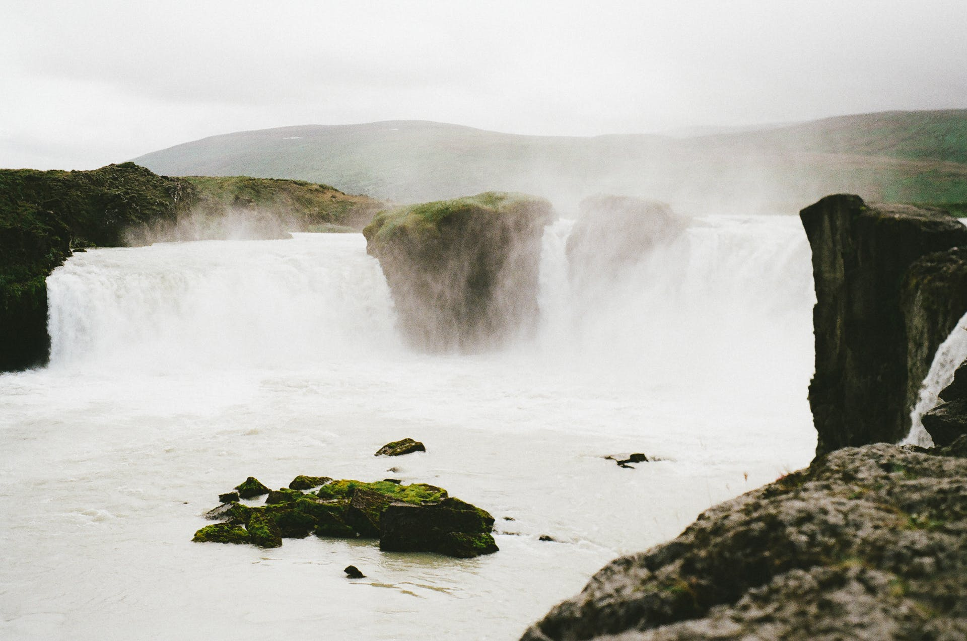 Waterfalls Under the Cloudy Sky