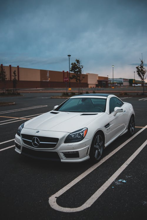 White Mercedes Benz Coupe Parked on Parking Lot