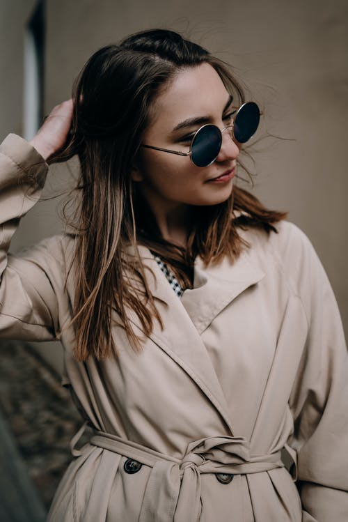 Stylish woman in trench on street