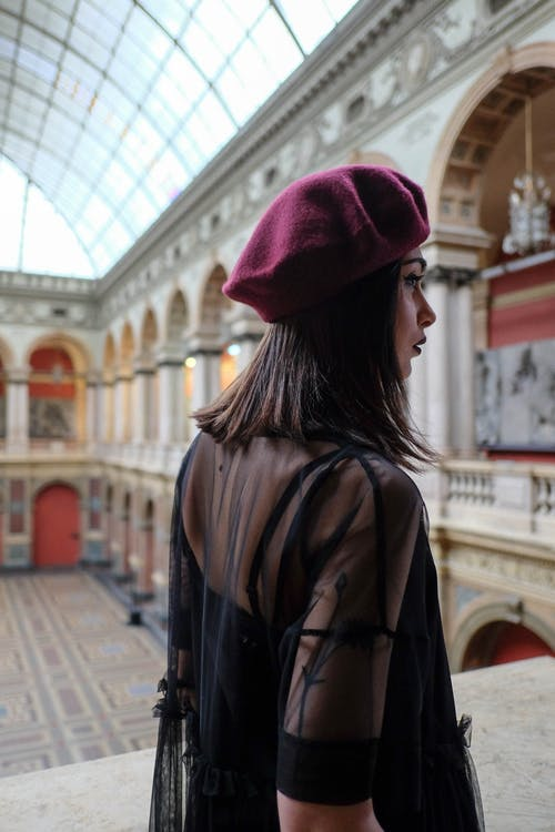 Trendy woman in beret in old building