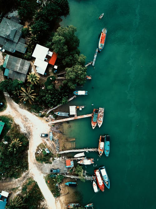 Aerial View of Green Boat on Water