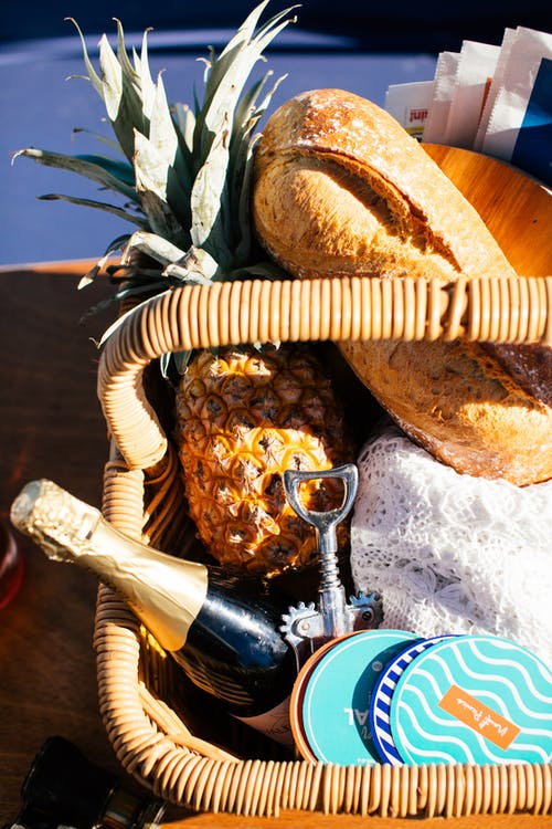 Wicker basket with food and wine