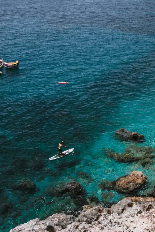 Boats floating on calm sea