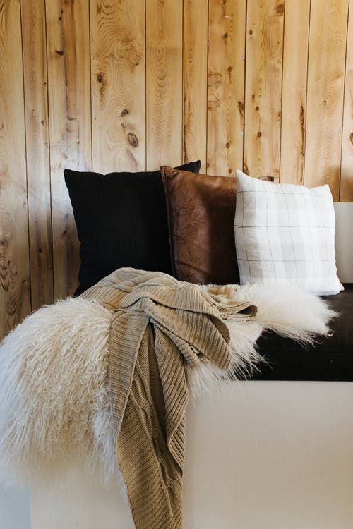 Comfy sofa with plaids and pillows