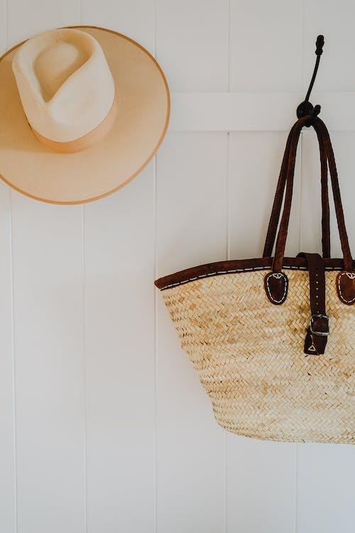 Hat and handbag on hooks