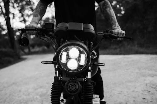 Unrecognizable man on motorbike on road