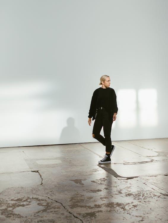 Young man walking on big hallway