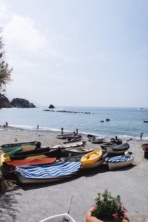 Small boats on sandy beach
