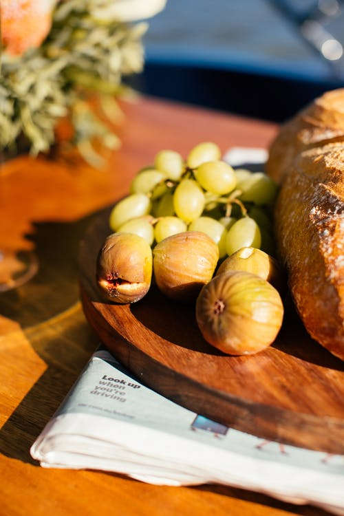Delicious fruits and fresh bread