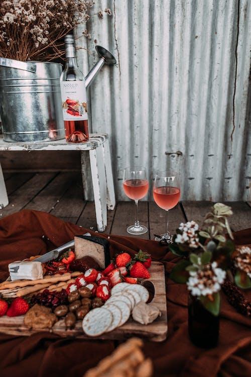 Wine and food on plaid