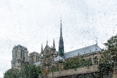 Facade of ancient Catholic cathedral on rainy day