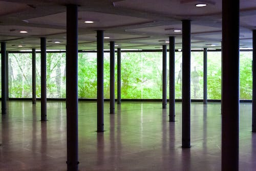 Interior of empty roofed space in green park