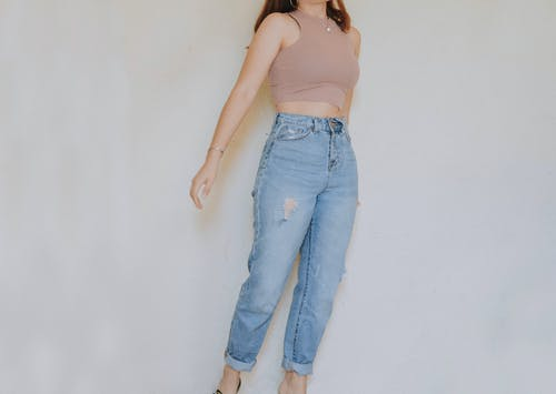 Woman in Blue Denim Jeans Standing