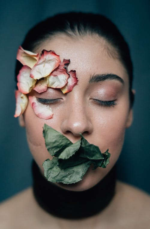 Woman With White Rose on Her Mouth