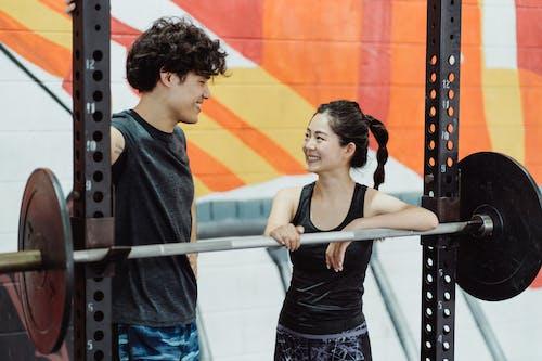 Ingyenes stockfotó activewear, ázsiai pár, edzőterem berendezések témában