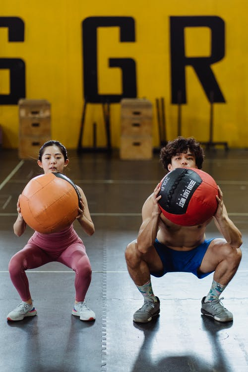 A Couple Working Out with Medicine Balls