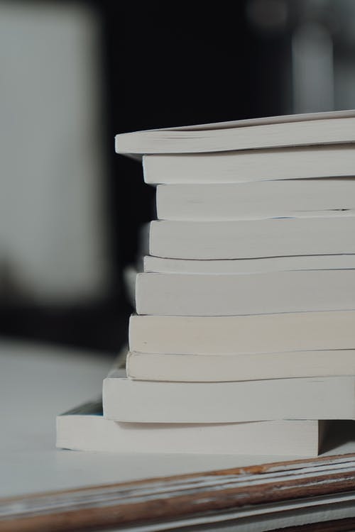 Stack of White Books on White Table