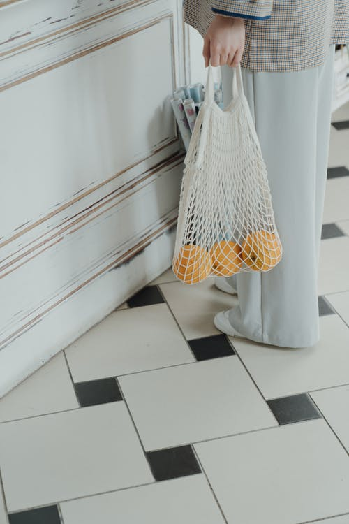 White and Yellow Textile Hanging on White Wooden Door