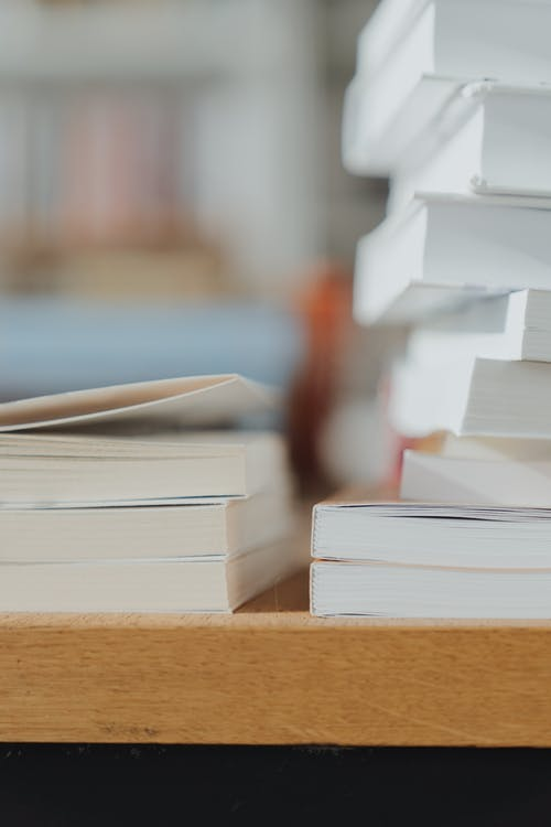 Shallow Focus Photo of Stack of Books