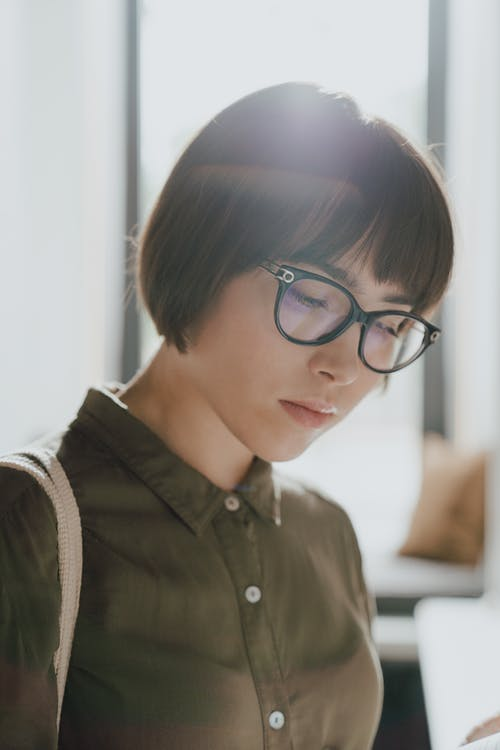 Boy in Black Button Up Shirt Wearing Black Framed Eyeglasses