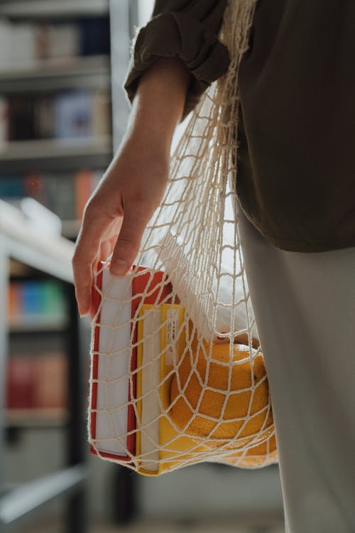 Person Holding White and Yellow Net