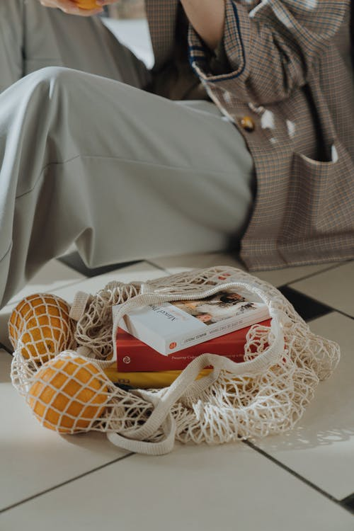 White and Red Labeled Box on White Knit Textile