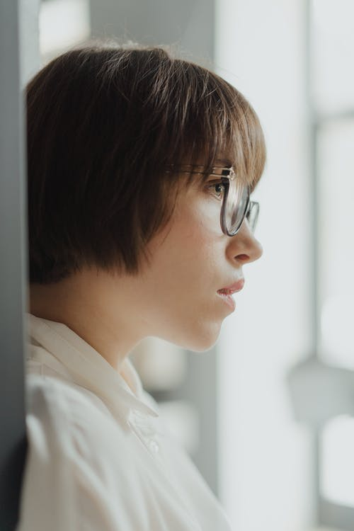 Boy in White Collared Shirt Wearing Eyeglasses