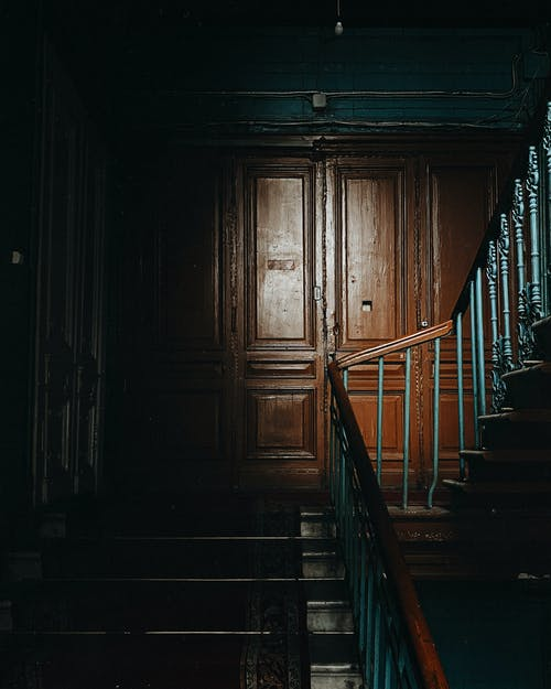 Large wooden door on staircase