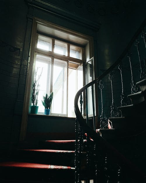Vintage staircase with big window