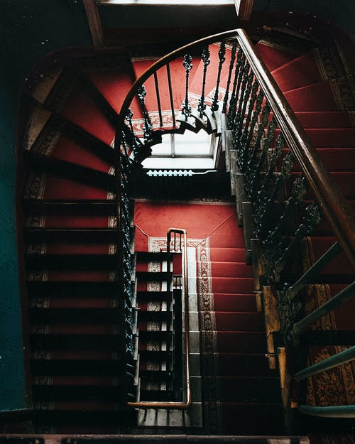 Vintage staircase with red carpet