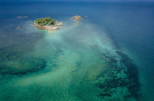 Small tropical island in blue ocean