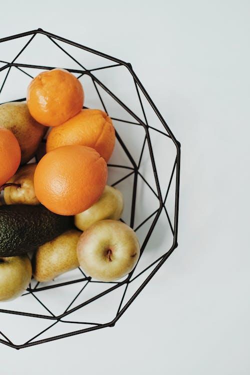 Orange Fruits on Black Metal Rack