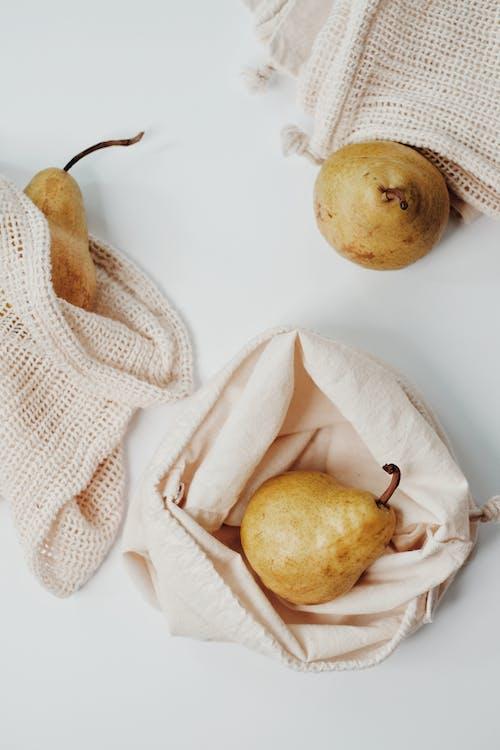 Yellow Round Fruit on White Textile