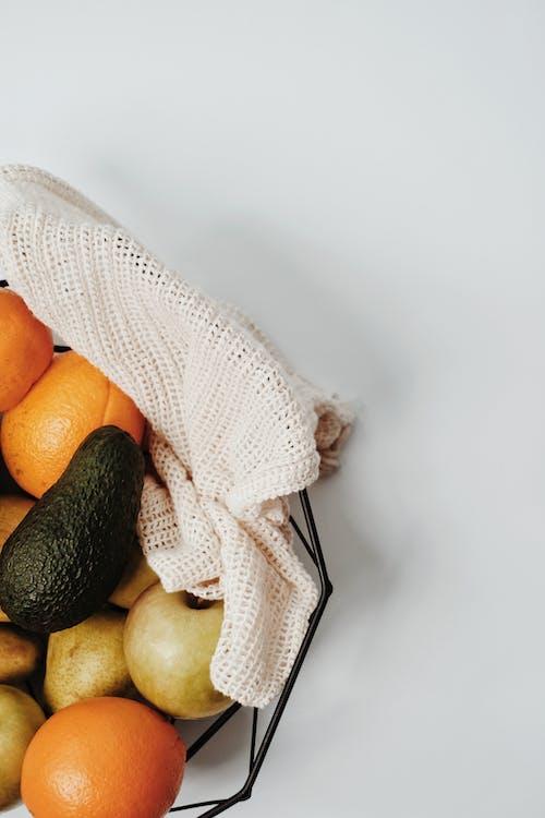 Orange Fruits on White Textile