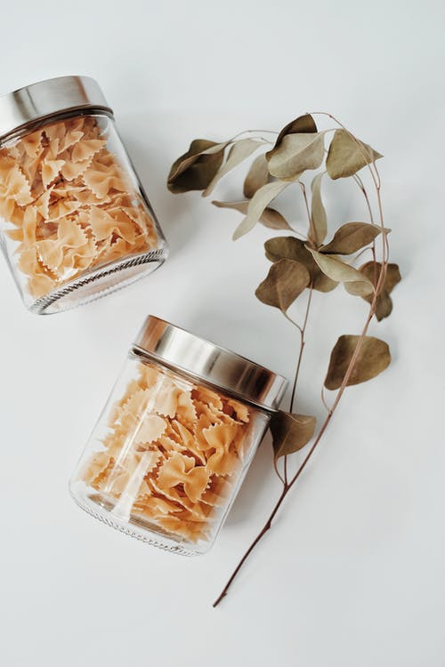 Brown and White Leaves in Clear Glass Jar
