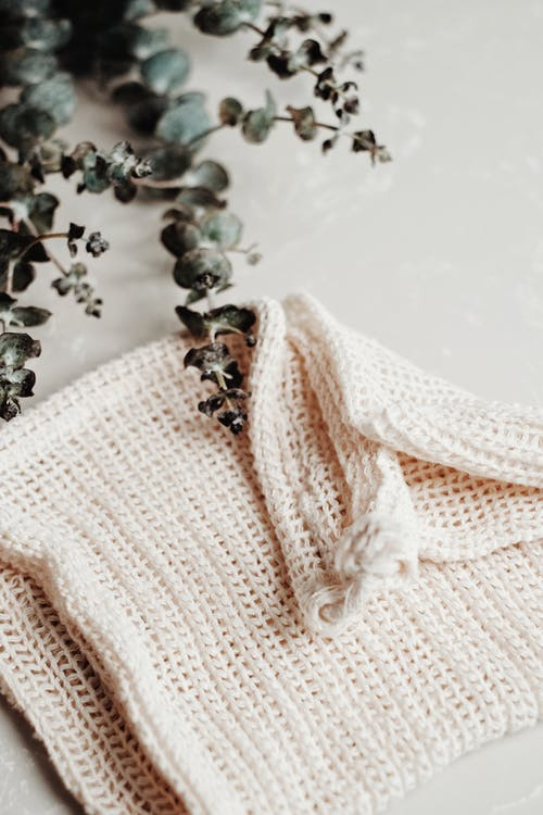 White Knit Textile With Silver and Gold Accessory