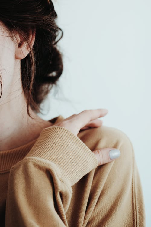 Woman in Brown Turtleneck Sweater