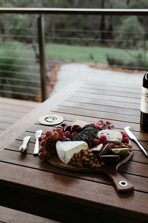 Delicious assorted delicacies on wooden table on veranda