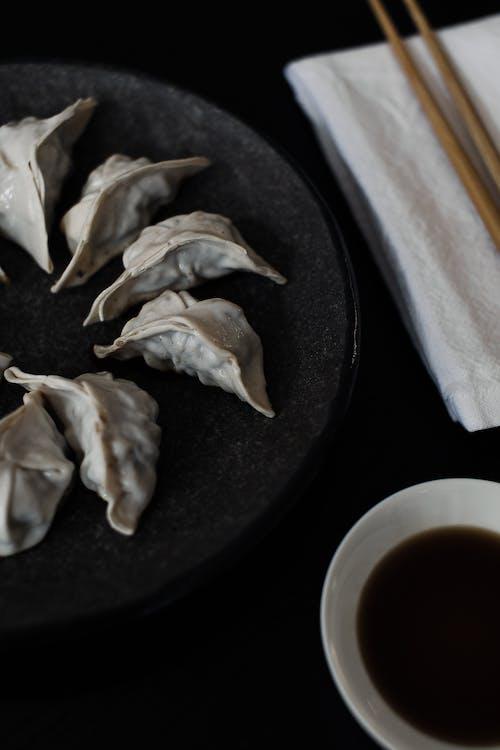Appetizing dumplings on black plate