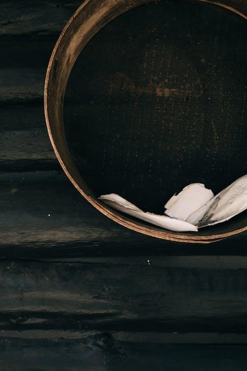 Metal basin on wooden wall