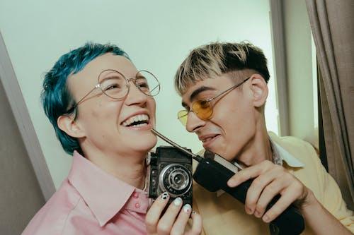 Woman in Pink Blazer Holding Black Camera
