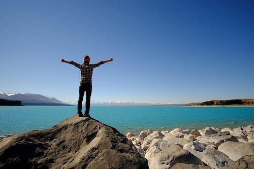 Gratis stockfoto met 1 man, 1 persoon, blauw meer, landschap