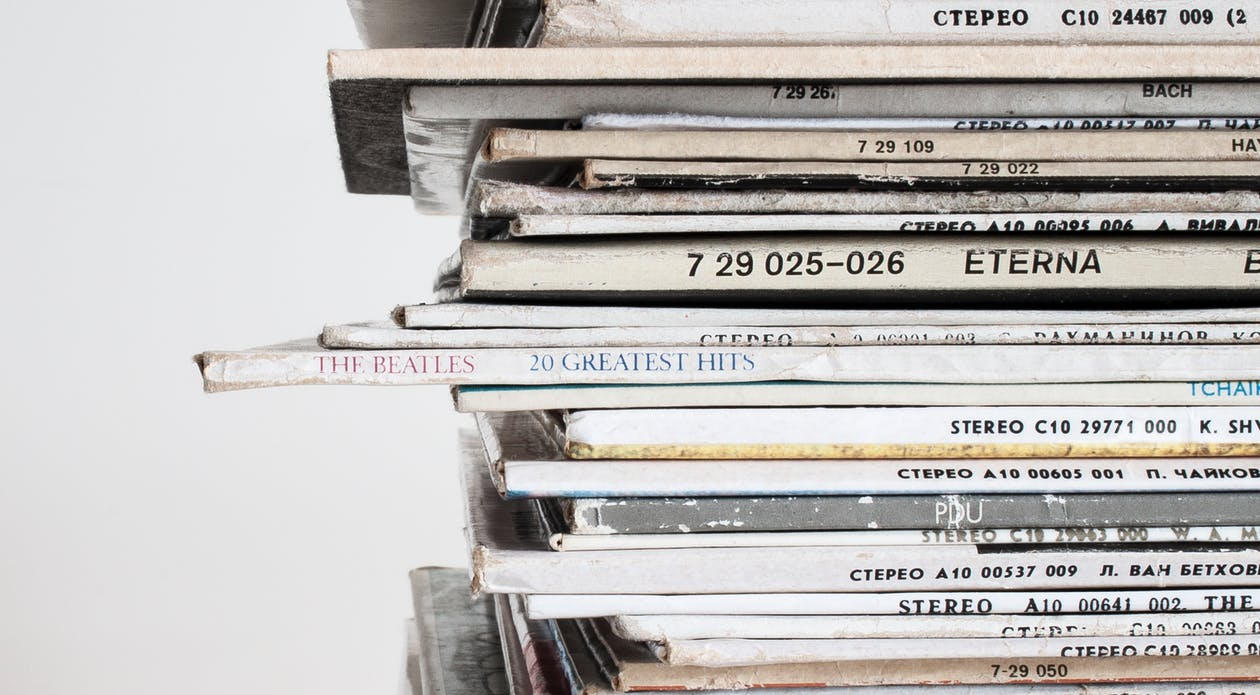 Piled Vinyl Records With White Background
