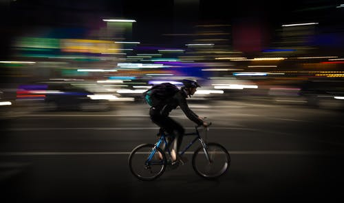 Photo Lapse Photo of Man Riding a Road Bicycle