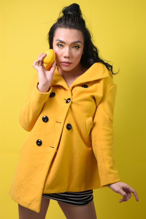 Woman in Yellow Coat Smiling