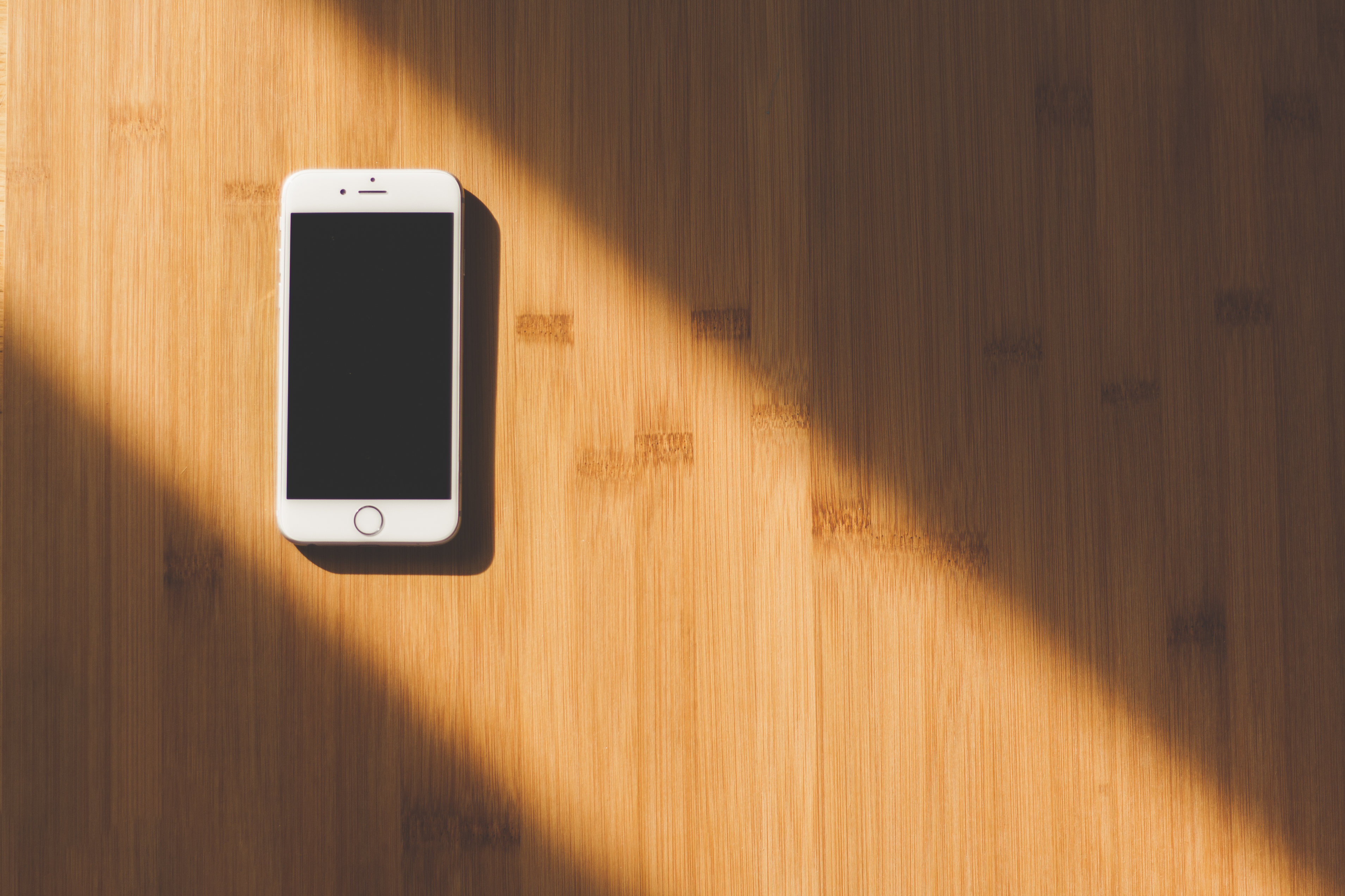iPhone device on a wooden desk
