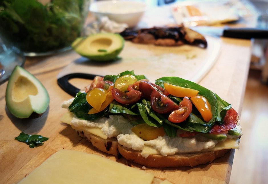 avocado, bread, cutting board