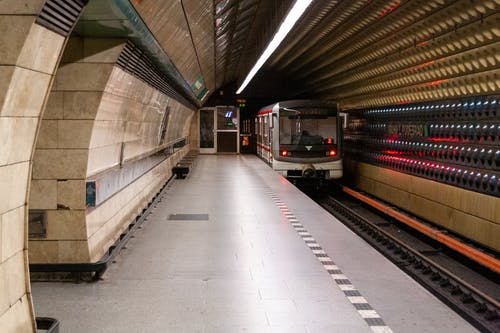 Metro station with train in modern city